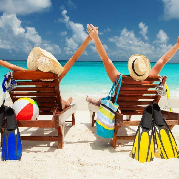 Honeymoon-relaxing-couple-on-beach-e1501666632133